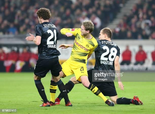 Benjamin Pavard of Stuttgart Andre Schuerrle of Dortmund and Holger Badstuber of Stuttgart battle for the ball during the Bundesliga match between...