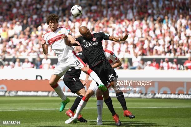 Benjamin Pavard of Stuttgart battles for the ball with David Pisot of Wuerzburg during the Second Bundesliga match between VfB Stuttgart and FC...