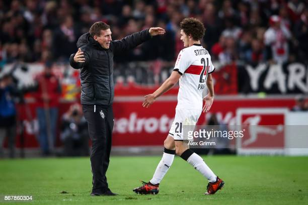 Benjamin Pavard of Stuttgart celebrates with head coach of Stuttgart Hannes Wolf after scoring his team's second goal to make it 20 during the...