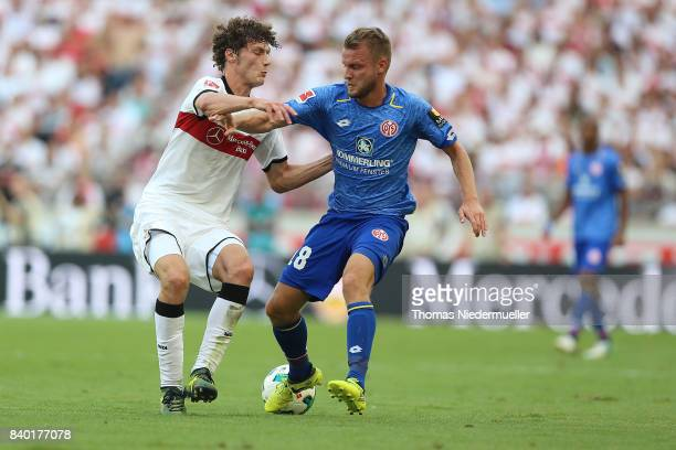 Benjamin Pavard of Stuttgart fights for the ball with Daniel Borsinski of Mainz during the Bundesliga match between VfB Stuttgart and 1 FSV Mainz 05...
