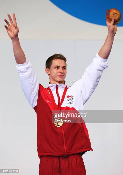 Benjamin Proud of England celebrates winning his gold medal during the medal ceremony for the Men's 50m Butterfly Final at Tollcross International...