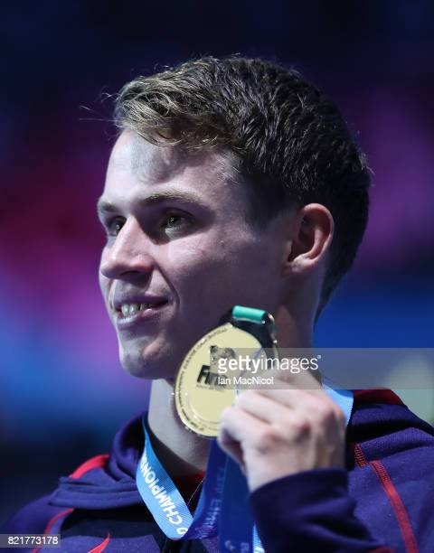 Benjamin Proud of Great Britain poses with his gold medal from the final of Men's 50m Butterfly on day eleven of the FINA World Championships at the...