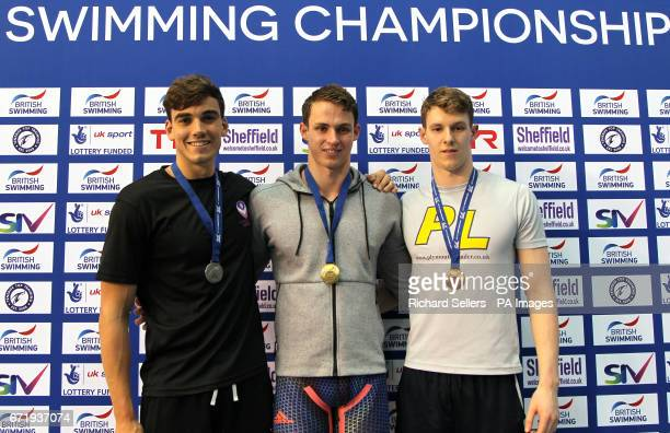 Benjamin Proud poses with his gold medal after winning the Men's 50m Butterfly alongside second placed Adam Barrett and third placed Robert Fannon...