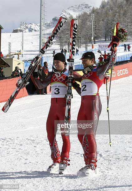Benjamin Raich of Austria and Hermann Maier of Germany celebrate at the Flower Ceremony after the Mens Alpine Skiing Giant Slalom competition on Day...