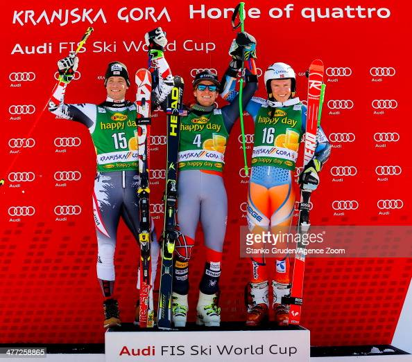 Benjamin Raich of Austria takes 2nd place Ted Ligety of the USA takes 1st place Henrik Kristoffersen of Norway takes 3rd place during the Audi FIS...