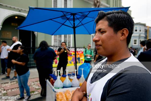 CA JULY 25 2017 Benjamin Ramirez the street vendor whose cart was overturned in Hollywood Ca stands next to his cart July 25 2016 In the background...