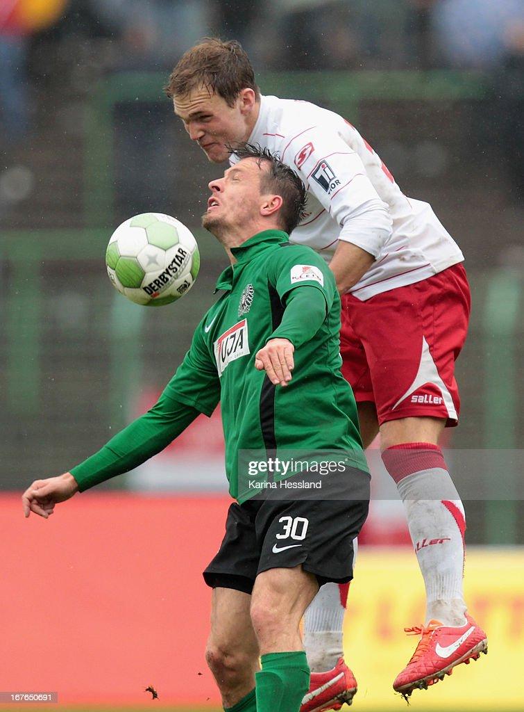 Benjamin Siegert of Muenster and Rafael Czichos of Erfurt battle for the ball during the 3rd Liga match between RW Erfurt and Preussen Muenster at Steigerwald Stadion on April 27, 2013 in Erfurt, Germany.