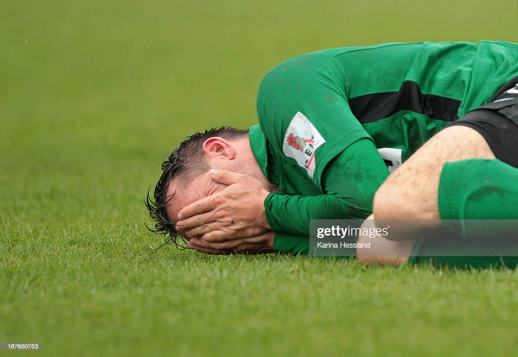 Benjamin Siegert of Muenster lies on the pitch during the 3rd Liga match between RW Erfurt and Preussen Muenster at Steigerwald Stadion on April 27, 2013 in Erfurt, Germany.