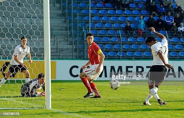 Benjamin Siegrist and Frederic Veseli of Switzerland look on while Elias Kachunga of Germany scoring his team's first goal during the EURO U19...