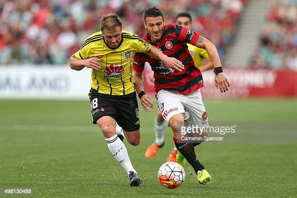 Benjamin Sigmund of the Phoenix and Frederico Piovaccari of the Wanderers contest the ball during the round seven ALeague match between Western...