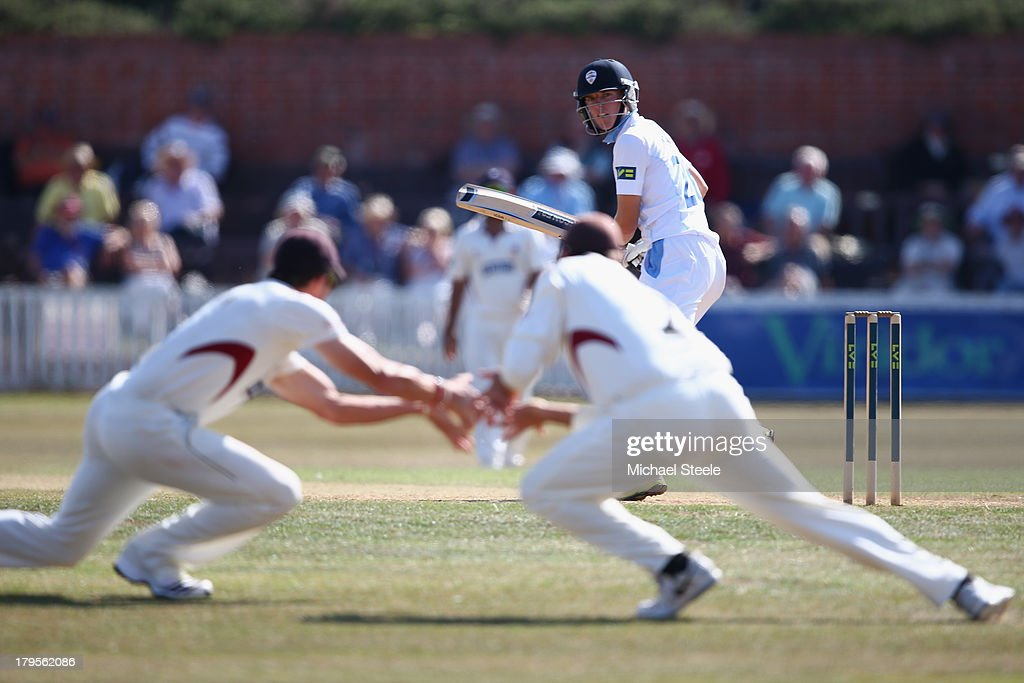 Benjamin Slater of Derbyshire looks back as he edges a delivery from Alfonso Thomas of Somerset which is fielded by <a gi-track='captionPersonalityLinkClicked' href=/galleries/search?phrase=Marcus+Trescothick&family=editorial&specificpeople=171643 ng-click='$event.stopPropagation()'>Marcus Trescothick</a> (R) and <a gi-track='captionPersonalityLinkClicked' href=/galleries/search?phrase=Nick+Compton&family=editorial&specificpeople=654760 ng-click='$event.stopPropagation()'>Nick Compton</a> during day three of the LV County Championship Division One match between Somerset and Derbyshire at The County Ground on September 5, 2013 in Taunton, England.