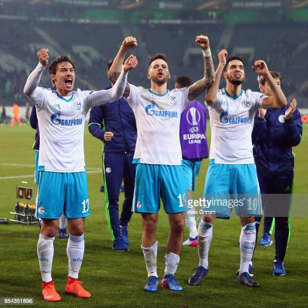 Benjamin Stambouli Guido Burgstaller and Nabil Bentaleb of Schalke celebrate with the fans after the UEFA Europa League Round of 16 second leg match...