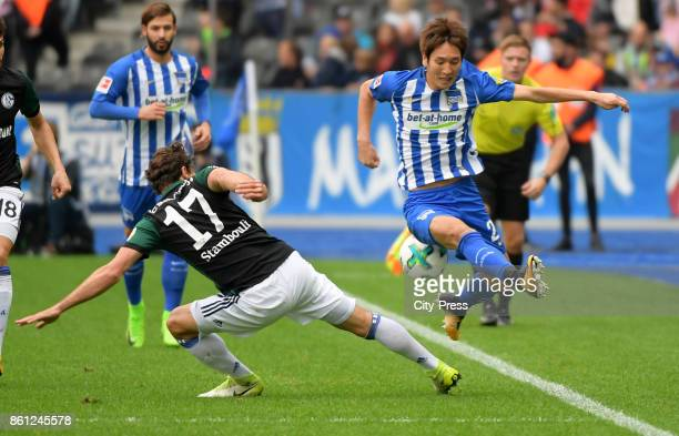 Benjamin Stambouli of FC Schalke 04 and Genki Haraguchi of Hertha BSC during the game between Hertha BSC and Schalke 04 on october 14 2017 in Berlin...