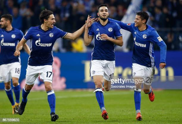 Benjamin Stambouli of Schalke 04 Nabil Bentaleb of Schalke 04 celebrates 10 Daniel Caligiuri of Schalke 04 during the German Bundesliga match between...