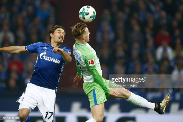 Benjamin Stambouli of Schalke 04 Yannick Gerhardt of VfL Wolfsburg during the German Bundesliga match between Schalke 04 v VFL Wolfsburg at the...