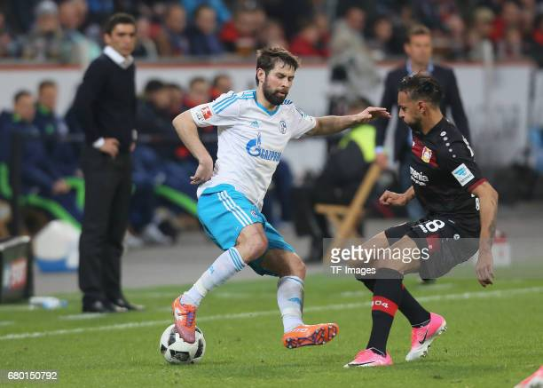 Benjamin Stambouli of Schalke and Karim Bellarabi of Leverkusen battle for the ball during to the Bundesliga match between Bayer 04 Leverkusen and FC...