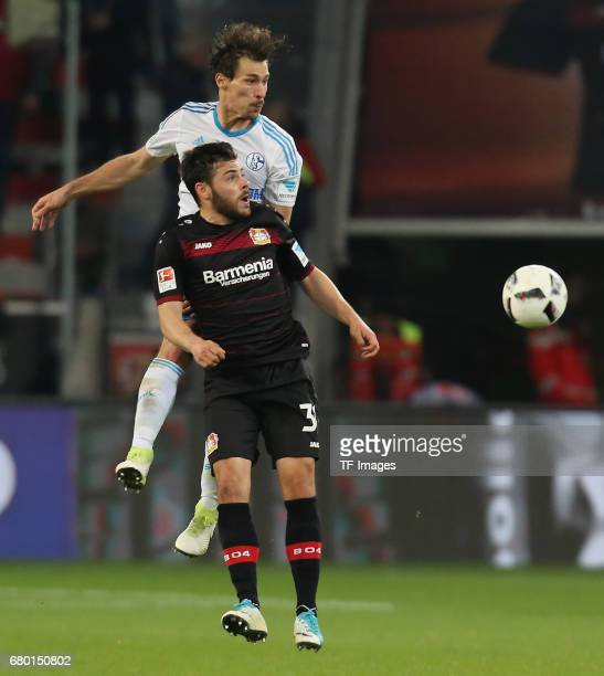 Benjamin Stambouli of Schalke and Kevin Volland of Leverkusen battle for the ball during to the Bundesliga match between Bayer 04 Leverkusen and FC...