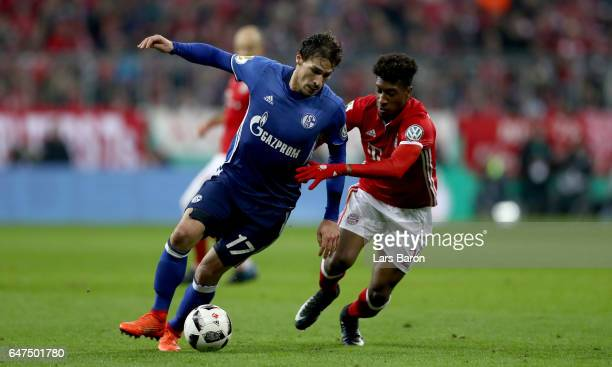Benjamin Stambouli of Schalke is challenged by Kingsley Coman of Bayern Muenchen during the DFB Cup quarter final between Bayern Muenchen and FC...