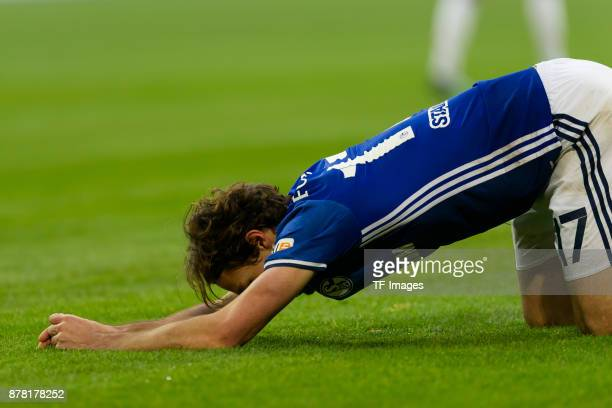 Benjamin Stambouli of Schalke on the ground during the Bundesliga match between FC Schalke 04 and Hamburger SV at VeltinsArena on November 19 2017 in...