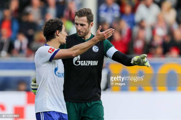 Benjamin Stambouli of Schalke speak with Goalkeeper Ralf Faehrmann of Schalke during the Bundesliga match between SportClub Freiburg and FC Schalke...