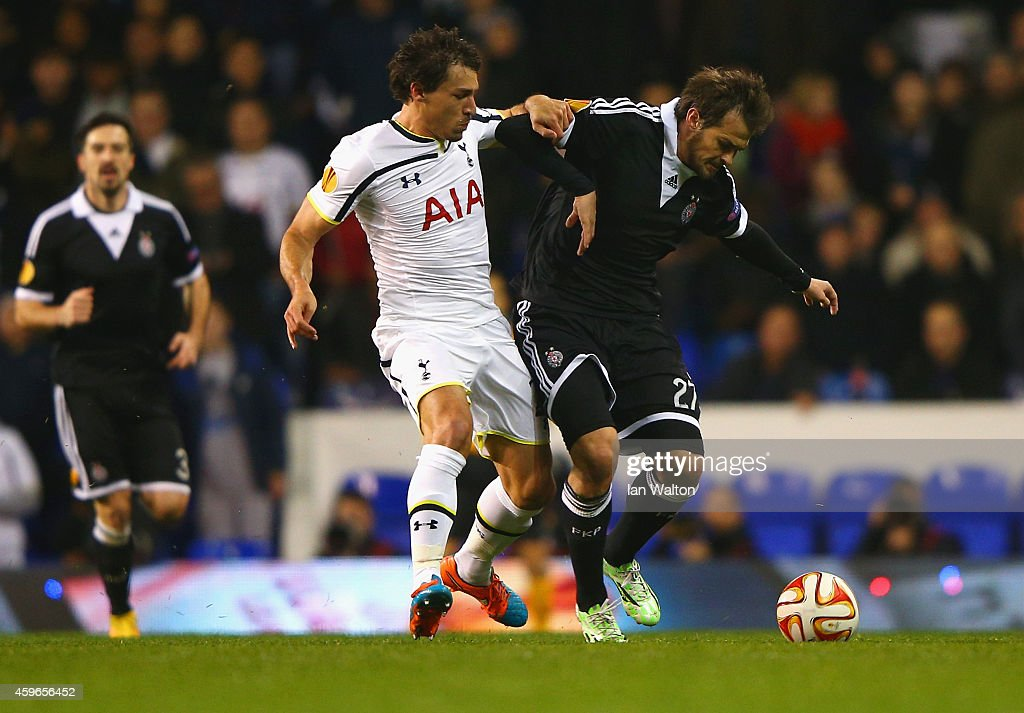 <a gi-track='captionPersonalityLinkClicked' href=/galleries/search?phrase=Benjamin+Stambouli&family=editorial&specificpeople=7133311 ng-click='$event.stopPropagation()'>Benjamin Stambouli</a> of Spurs and <a gi-track='captionPersonalityLinkClicked' href=/galleries/search?phrase=Danko+Lazovic&family=editorial&specificpeople=2219062 ng-click='$event.stopPropagation()'>Danko Lazovic</a> of Partizan Belgrade compete for the ball during the UEFA Europa League group C match between Tottenham Hotspur FC and FK Partizan at White Hart Lane on November 27, 2014 in London, United Kingdom.