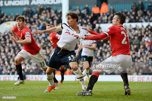 Benjamin Stambouli of Spurs is manhandled by Robin van Persie of Manchester United during the Barclays Premier League match between Tottenham Hotspur...