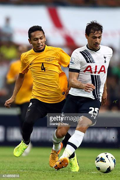 Benjamin Stambouli of Tottenham Hotspur clashes with Mohd Nasir of Malaysia XI during the preseason friendly match between Malaysia XI and Tottenham...