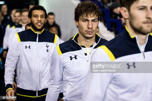 Benjamin Stambouli of Tottenham Hotspur exits the players tunnel alongside Ben Davies and Mousa Dembele during the FA Cup Third Round Replay match...