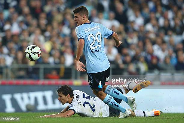 Benjamin Stambouli of Tottenham Hotspur falls affter he was tackled by George Blackwood of Sydney FC during the international friendly match between...