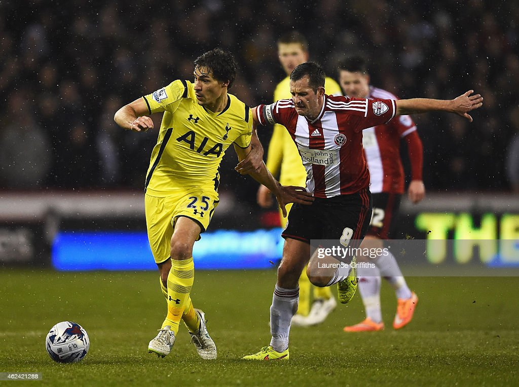 <a gi-track='captionPersonalityLinkClicked' href=/galleries/search?phrase=Benjamin+Stambouli&family=editorial&specificpeople=7133311 ng-click='$event.stopPropagation()'>Benjamin Stambouli</a> of Tottenham Hotspur is challenged by <a gi-track='captionPersonalityLinkClicked' href=/galleries/search?phrase=Michael+Doyle+-+Soccer+Player&family=editorial&specificpeople=13446353 ng-click='$event.stopPropagation()'>Michael Doyle</a> of Sheffield United during the Capital One Cup Semi-Final Second Leg match between Sheffield United and Tottenham Hotspur at Bramall Lane on January 28, 2015 in Sheffield, England.