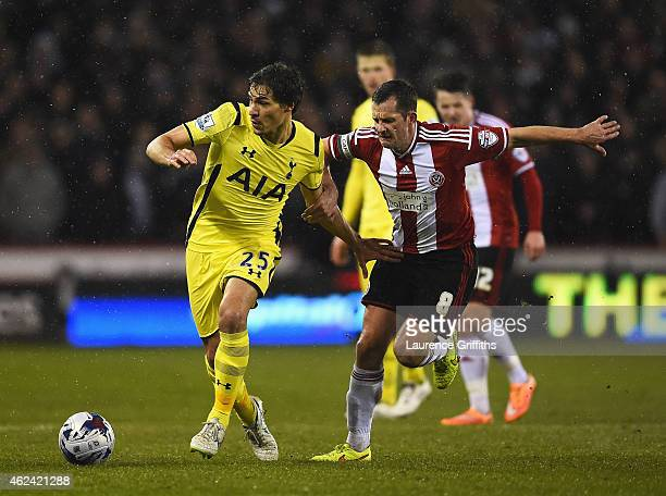 Benjamin Stambouli of Tottenham Hotspur is challenged by Michael Doyle of Sheffield United during the Capital One Cup SemiFinal Second Leg match...