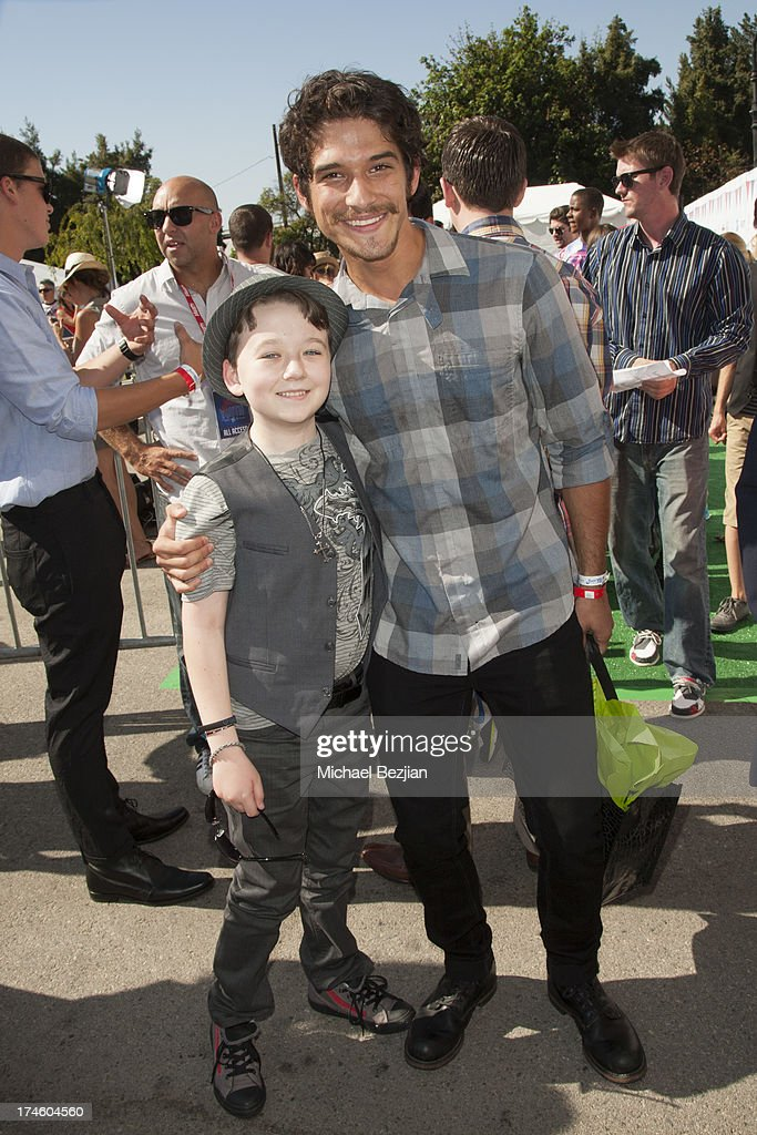 Benjamin Stockham and <a gi-track='captionPersonalityLinkClicked' href=/galleries/search?phrase=Tyler+Posey&family=editorial&specificpeople=3201481 ng-click='$event.stopPropagation()'>Tyler Posey</a> attend Flips Audio At Variety Power of Youth at Universal Studios Backlot on July 27, 2013 in Universal City, California.