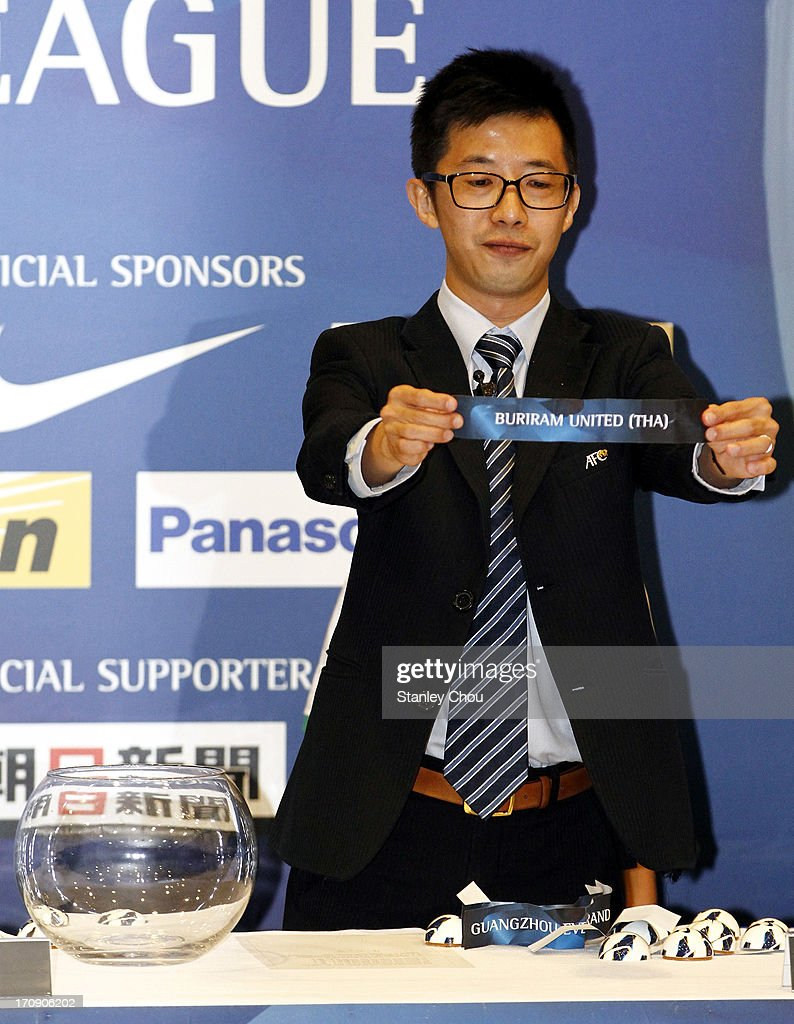Benjamin Tan, Head of the Club Competition of the Asian Football Confederation, draws out Buriram United of Thailand during the 2013 AFC Champions League Quarter Finals Knock-out Stage Draw at the AFC House on June 20, 2013 in Kuala Lumpur, Malaysia.