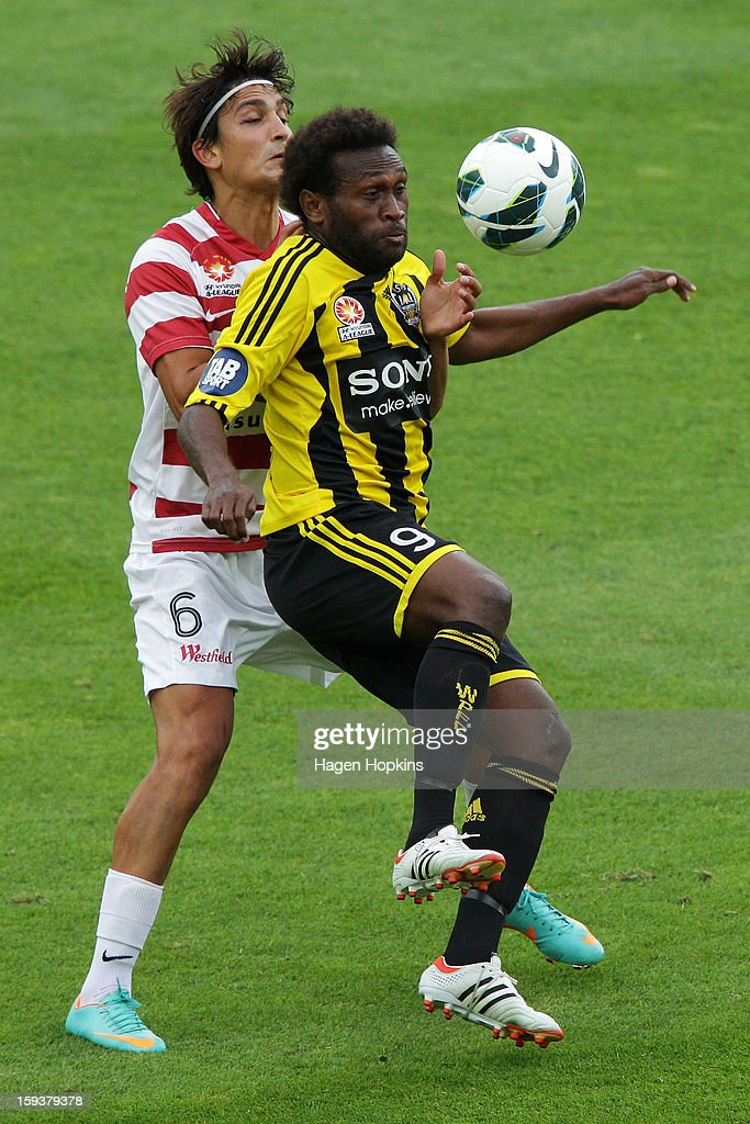 Benjamin Totori of the Phoenix controls the ball under pressure from Jerome Polenz of the Wanderers during the round 16 A-League match between the Wellington Phoenix and the Western Sydney Wanderers at Westpac Stadium on January 13, 2013 in Wellington, New Zealand.