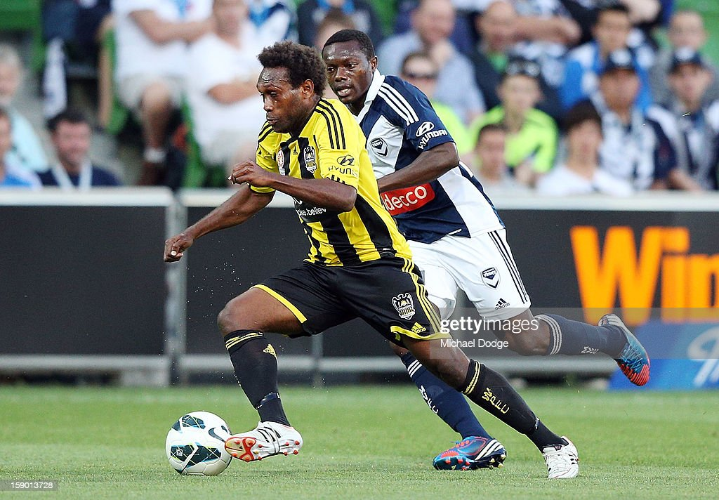 Benjamin Totori of the Wellington Phoenix runs with the ball during the round 15 A-League match between the Melbourne Victory and Wellington Phoenix at AAMI Park on January 5, 2013 in Melbourne, Australia.