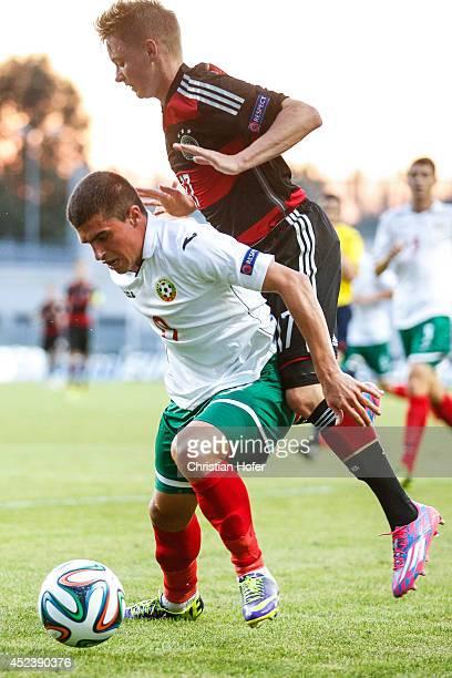 Benjamin Truemmer of Germany challenges Aleksandar Veselinov Vasilev of Bulgaria during the UEFA Under19 European Championship match between U19...
