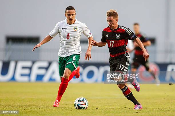 Benjamin Truemmer of Germany challenges Hristofor Hubchev of Bulgaria during the UEFA Under19 European Championship match between U19 Germany and U19...