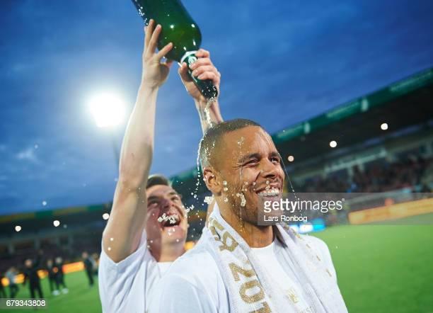 Benjamin Verbic and Mathias Zanka Jorgensen of FC Copenhagen celebrate with champagne as danish champions after the Danish Alka Superliga match...