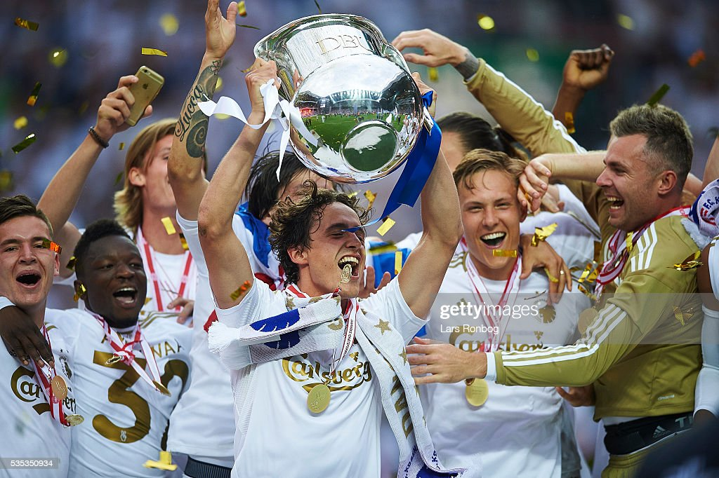 Benjamin Verbic, Danny Amankwaa, Thomas Delaney, Ludvig Augustinsson and Stephan Andersen of FC Copenhagen lifts the trophy and celebrate with teammates as Danish Champions 2015/2016 after the Danish Alka Superliga match between FC Copenhagen and AGF Aarhus at Telia Parken Stadium on May 29, 2016 in Copenhagen, Denmark.