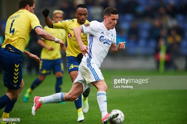 Benjamin Verbic of FC Copenhagen and Lebogang Phiri of Brondby IF compete for the ball during the Danish Alka Superliga match between Brondby IF and...
