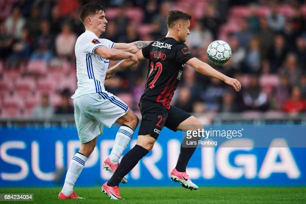 Benjamin Verbic of FC Copenhagen and Mikkel Duelund of FC Midtjylland compete for the ball during the Danish Alka Superliga match between FC...
