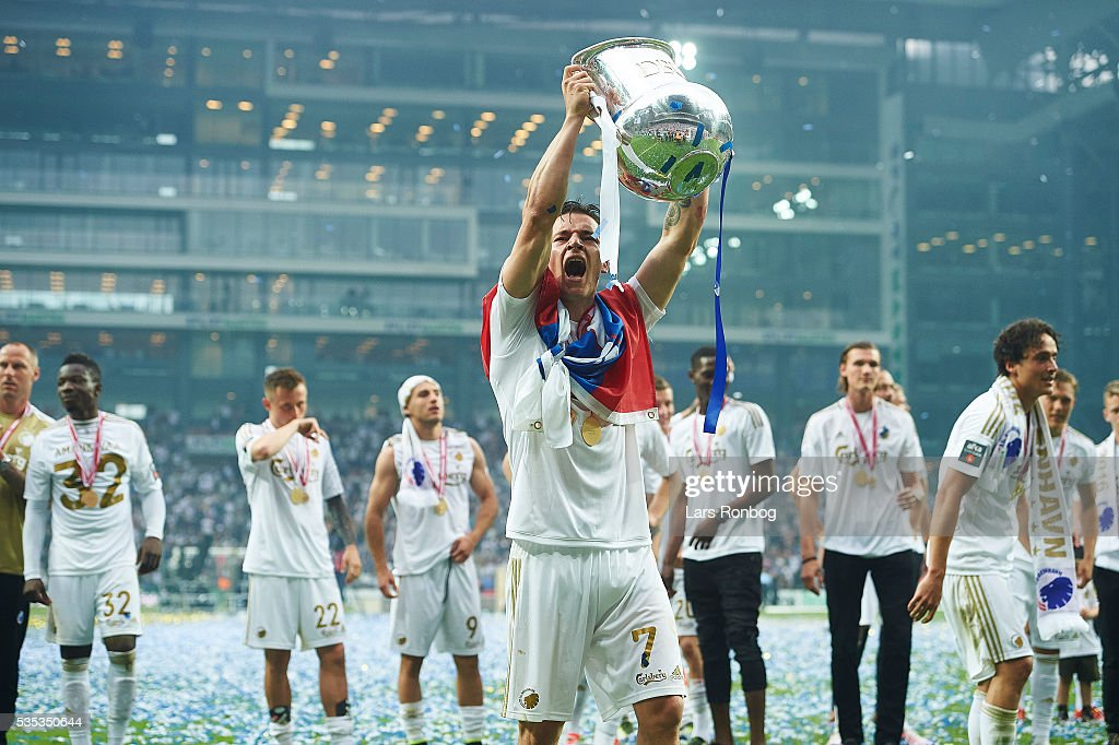 Benjamin Verbic of FC Copenhagen lifts the trophy and celebrate with teammates as Danish Champions 2015/2016 after the Danish Alka Superliga match between FC Copenhagen and AGF Aarhus at Telia Parken Stadium on May 29, 2016 in Copenhagen, Denmark.