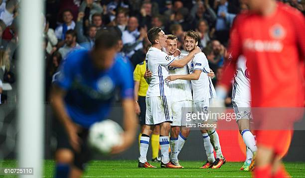 Benjamin Verbic Peter Ankersen and Rasmus Falk of FC Copenhagen celebrate after scoring their first goal during the UEFA Champions League match...