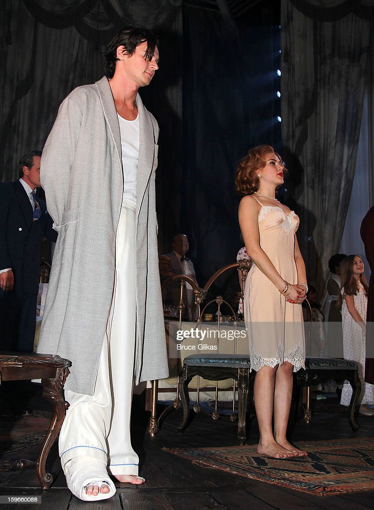 Benjamin Walker as 'Brick' and Scarlett Johansson as 'Maggie the Cat' take their Opening Night curtain call in 'Cat On A Hot Tin Roof' on Broadway at The Richard Rodgers Theatre on January 17, 2013 in New York City.