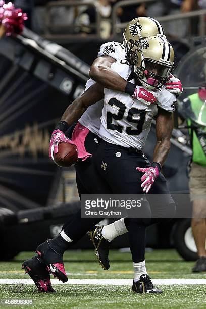 Benjamin Watson celebrates with Khiry Robinson of the New Orleans Saints following a touchdown in overtime against the Tampa Bay Buccaneers at the...