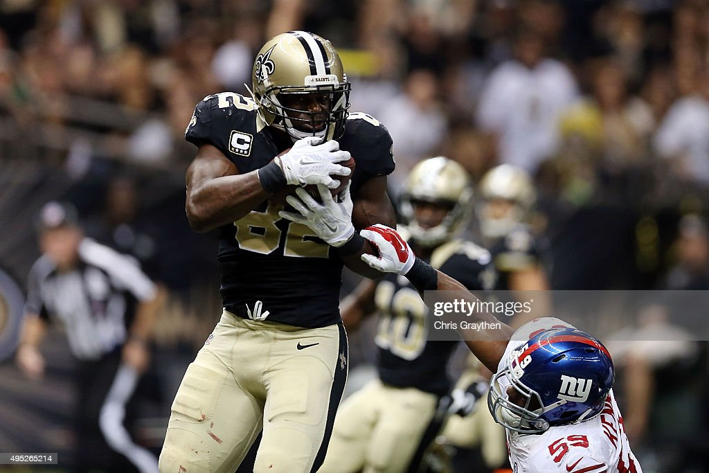 Benjamin Watson of the New Orleans Saints catches a touchdown in front of Devon Kennard of the New York Giants during the third quarter of a game at...