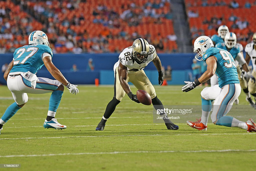 <a gi-track='captionPersonalityLinkClicked' href=/galleries/search?phrase=Benjamin+Watson+-+American+Football+Player&family=editorial&specificpeople=15154817 ng-click='$event.stopPropagation()'>Benjamin Watson</a> #82 of the New Orleans Saints goes after a loose ball against Jason Trusnik #93 and Jimmy Wilson #27 of the Miami Dolphins during a preseason game on August 29, 2013 at Sun Life Stadium in Miami Gardens, Florida. The Dolphins defeated the Saints 24-21.