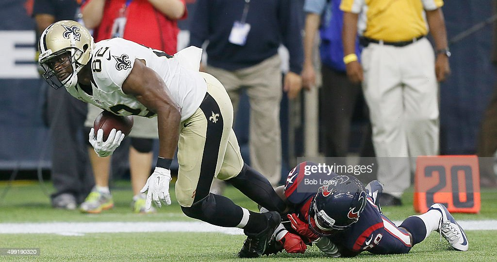 <a gi-track='captionPersonalityLinkClicked' href=/galleries/search?phrase=Benjamin+Watson+-+American+Football+Player&family=editorial&specificpeople=15154817 ng-click='$event.stopPropagation()'>Benjamin Watson</a> #82 of the New Orleans Saints is tackled by <a gi-track='captionPersonalityLinkClicked' href=/galleries/search?phrase=Andre+Hal&family=editorial&specificpeople=8281332 ng-click='$event.stopPropagation()'>Andre Hal</a> #29 of the Houston Texans in the fourth quarter on November 29, 2015 at NRG Stadium in Houston, Texas.