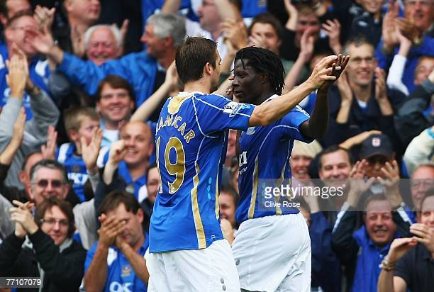 Benjani of Portsmouth celebrates his goal with teammate Niko Kranjcar during the Barclays Premier League match between Portsmouth and Reading at...