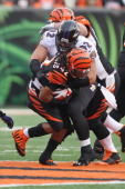 BenJarvus GreenEllis of the Cincinnati Bengals runs the football upfield against Haloti Ngata of the Baltimore Ravens during a game at Paul Brown...